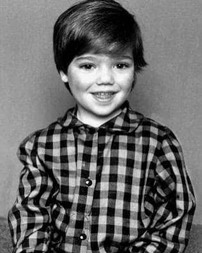 A black and white photo of Anthony Callea as a young boy
