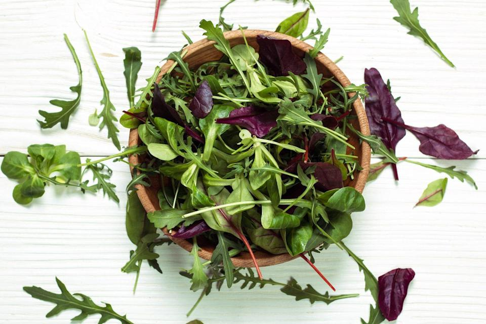 """<p>Leafy greens that include kale, spinach, collard greens, arugula, Swiss chard, beet greens, and romaine lettuce are excellent sources of potassium. Think outside of the salad and glorify your greens in omelets, <a href=""""https://www.prevention.com/food-nutrition/g20465600/green-smoothie-recipes/"""" rel=""""nofollow noopener"""" target=""""_blank"""" data-ylk=""""slk:smoothies"""" class=""""link rapid-noclick-resp"""">smoothies</a>, and sandwiches. </p><p><strong>Try it: </strong>If you want to sneak greens into a flavorful meal, try this <a href=""""https://www.prevention.com/food-nutrition/recipes/a20472583/garlic-shrimp-and-kale-stir-fry/"""" rel=""""nofollow noopener"""" target=""""_blank"""" data-ylk=""""slk:garlic shrimp and kale stir-fry"""" class=""""link rapid-noclick-resp"""">garlic shrimp and kale stir-fry</a>.</p>"""