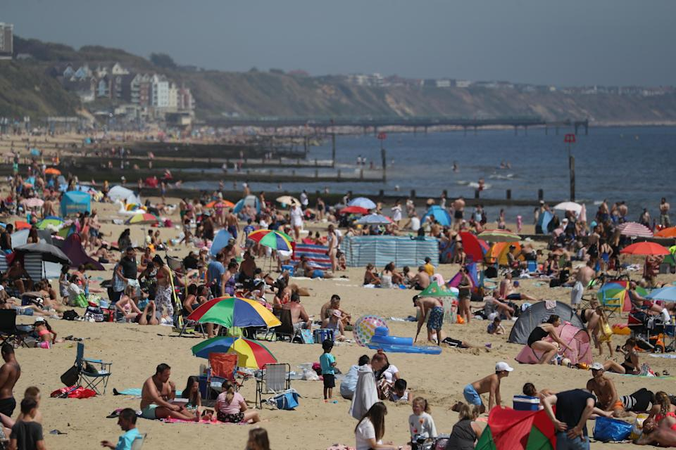 People enjoy the hot weather at Bournemouth beach in Dorset. (Getty Images)