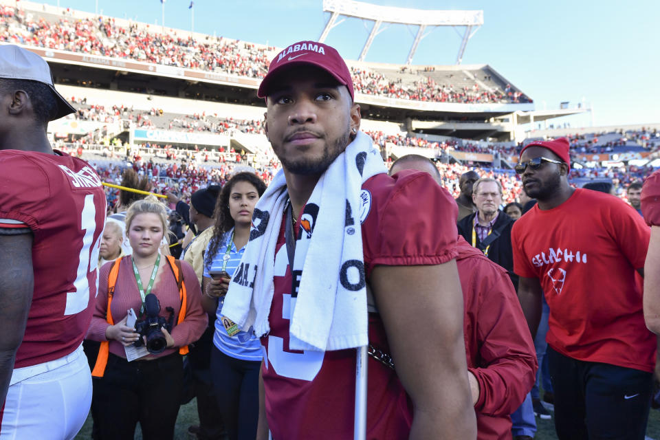 Alabama quarterback Tua Tagovailoa (13) walks to the podium during the award ceremony after the Citrus Bowl win over Michigan. (Roy K. Miller/Icon Sportswire via Getty Images)