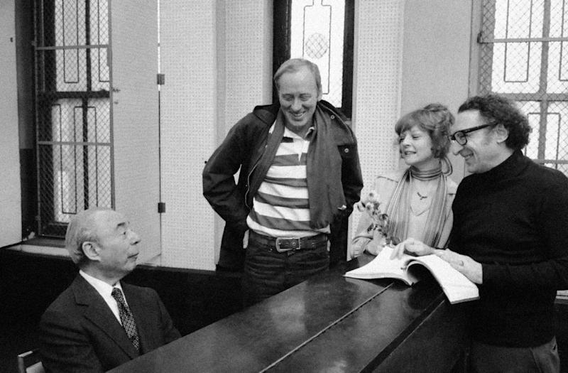 "FILE - Composer Richard Rodgers, left, begins prepares for the opening of his newest musical ""REX"", which stars Nicol Williamson, center, and Penny Fuller on Jan. 19, 1976 in New York City. Williamson, the British actor, best known for his role as the wizard Merlin in the 1981 film ""Excalibur,"" has died of esophageal cancer. He was 75. His son Luke said Wednesday  Jan. 25 2012 that his father died Dec. 16 in Amsterdam, where he had lived for more than two decades. (AP Photo/Marty Lederhandler, file)"
