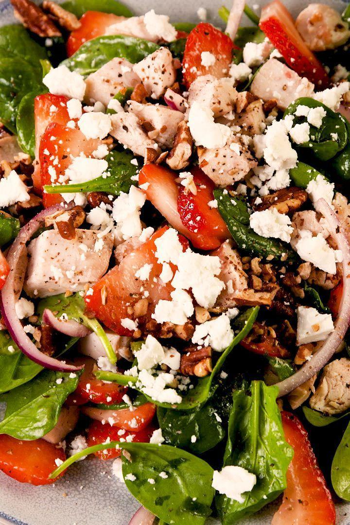 """<p>Even so-called <a href=""""https://www.delish.com/uk/cooking/a29469948/how-to-cook-spinach/"""" rel=""""nofollow noopener"""" target=""""_blank"""" data-ylk=""""slk:spinach"""" class=""""link rapid-noclick-resp"""">spinach</a> haters will love this recipe. The combination of sweet strawberries, herb chicken, creamy goat cheese, and spicy red onions make you forget the fact that you're eating <a href=""""https://www.delish.com/uk/cooking/recipes/a31952820/prawn-salad/"""" rel=""""nofollow noopener"""" target=""""_blank"""" data-ylk=""""slk:salad"""" class=""""link rapid-noclick-resp"""">salad</a>. It's a miracle! </p><p>Get the <a href=""""http://www.delish.com/uk/cooking/recipes/a32484972/easy-strawberry-spinach-salad-recipe/"""" rel=""""nofollow noopener"""" target=""""_blank"""" data-ylk=""""slk:Strawberry Spinach Salad"""" class=""""link rapid-noclick-resp"""">Strawberry Spinach Salad</a> recipe.</p>"""