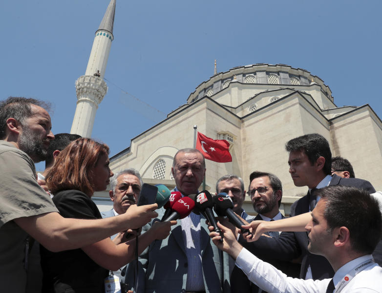 Turkish President Recep Tayyip Erdogan speaks to the media after Friday prayers, in Istanbul, Friday, June 7, 2019. Erdogan says his country is determined to protect Turkish Cypriots' rights to gas deposits in the eastern Mediterranean.(Presidential Press Service via AP, Pool)