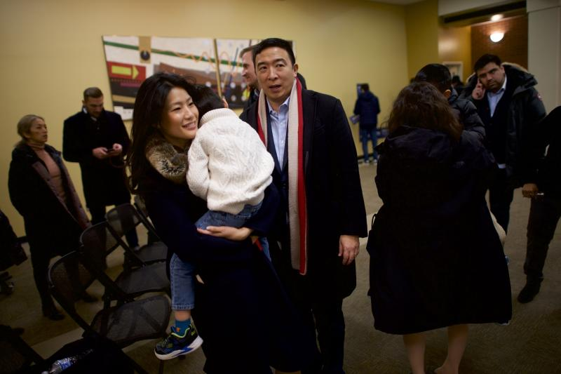 MT. PLEASANT, IA - JANUARY 24: Democratic presidential candidate Andrew Yang and wife, Evelyn, carry their sons to the campaign bus following a rally at Iowa Wesleyan University on January 24, 2020 in Mt. Pleasant, Iowa. Yang continues his 17 day bus tour through Iowa today with five town halls along the southeastern state line. (Photo by Mark Makela/Getty Images)