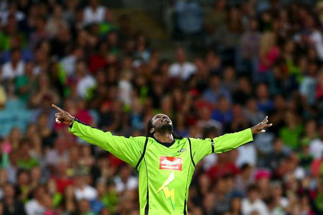 Chris Gayle of the Thunder celebrates taking the wicket of Moises Henriques of the Sixers during the Big Bash League match between Sydney Thunder and the Sydney Sixers at ANZ Stadium on December 30, 2012 in Sydney, Australia.  (Photo by Mark Kolbe/Getty Images)