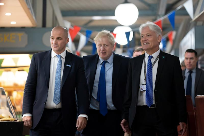 Boris Johnson walks with Northern Powerhouse minister Jake Berry and Doncaster Council chief executive Damian Allen
