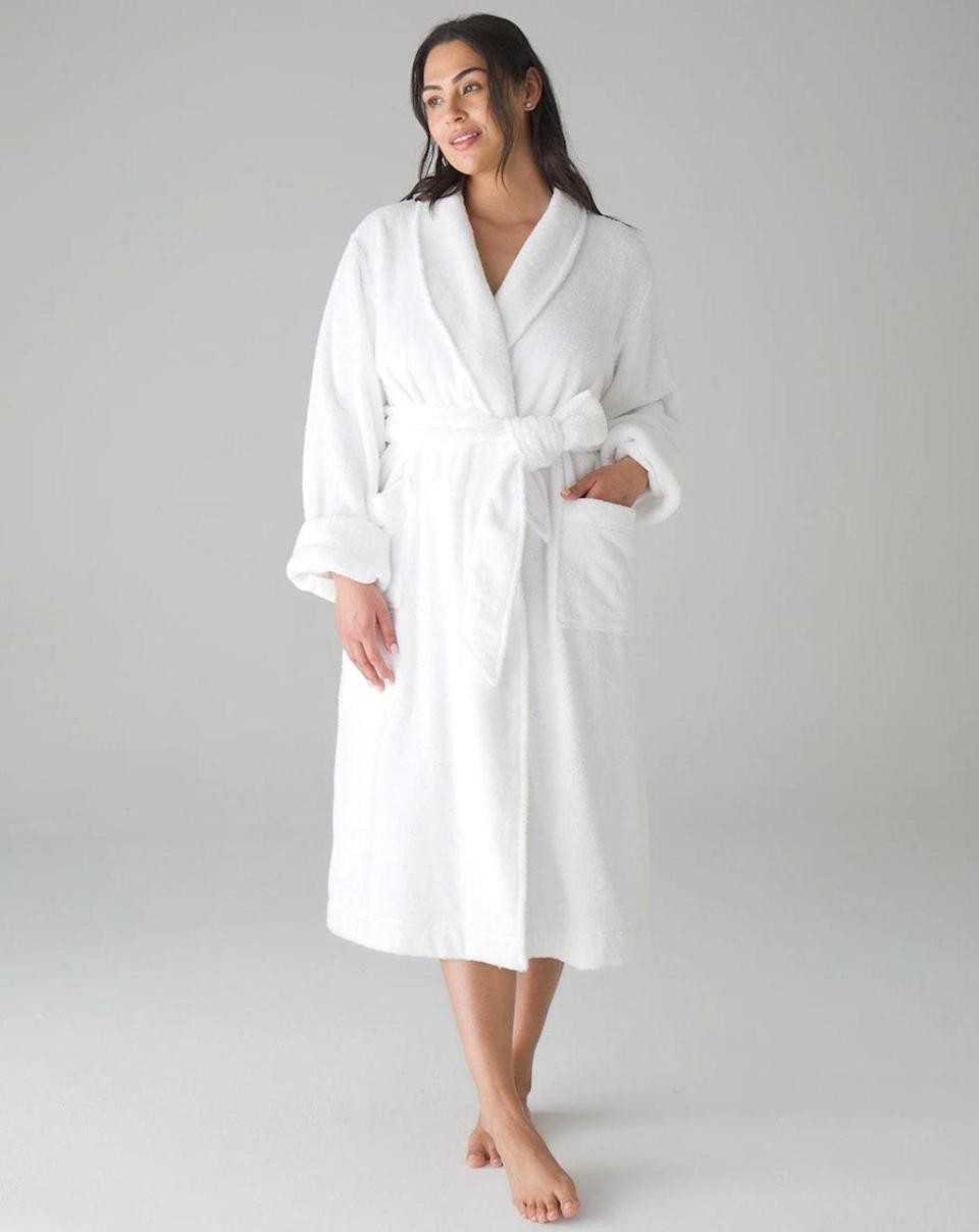 """Lounging in a <a href=""""https://www.cntraveler.com/story/best-spa-hotel-luxury-robes?mbid=synd_yahoo_rss"""" rel=""""nofollow noopener"""" target=""""_blank"""" data-ylk=""""slk:big, fluffy robe"""" class=""""link rapid-noclick-resp"""">big, fluffy robe</a> is one of the highlights of any hotel stay or spa experience. Bring that bit of luxury home by gifting her Soma's Restore Robe this Mother's Day: It's made of a thick cotton, with pockets, a removable tie belt, and long sleeves that can be cuffed for a better fit. $118, Soma. <a href=""""https://www.soma.com/store/product/soma+restore+rr+cotton+robe/570306319?color=2240&catId=search"""" rel=""""nofollow noopener"""" target=""""_blank"""" data-ylk=""""slk:Get it now!"""" class=""""link rapid-noclick-resp"""">Get it now!</a>"""