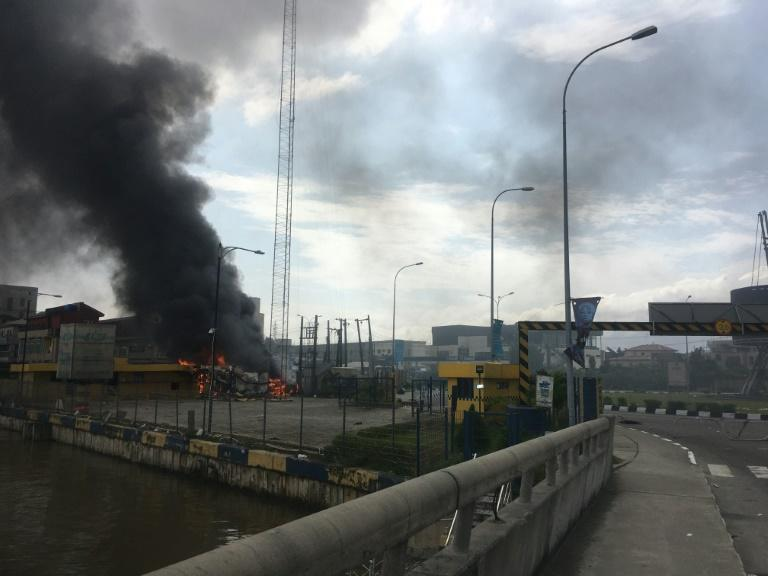 Buildings were torched in Lagos after the shooting