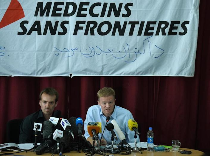 General Director of Doctors Without Borders, or Médecins Sans Frontières (MSF), Christopher Stokes (R) and Country Representative for MSF in Afghanistan Guilhem Molinie speak during a press conference at the MSF office in Kabul on October 8, 2015 (AFP Photo/Wakil Kohsar)