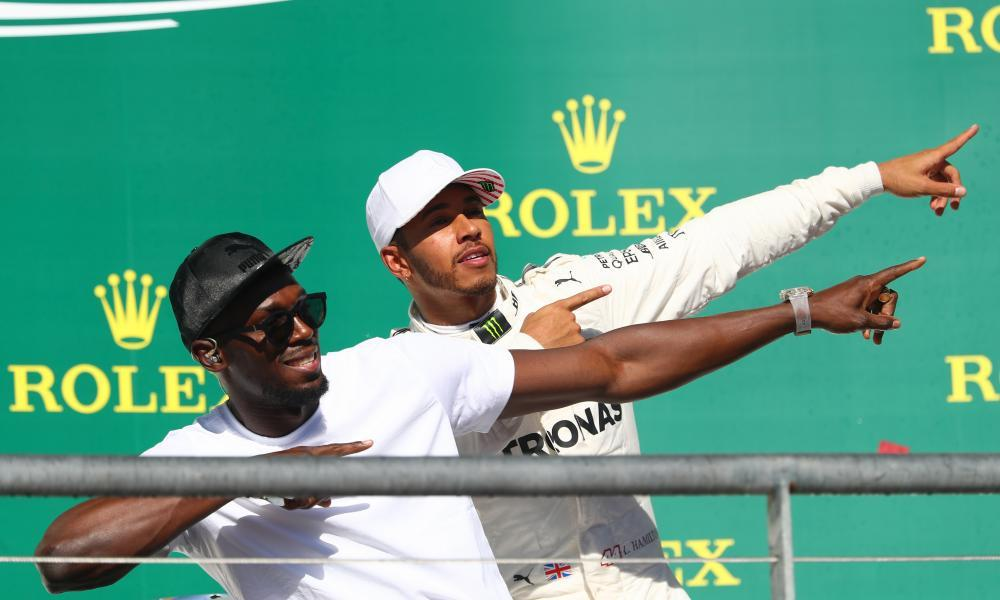 Lewis Hamilton, right, celebrates his victory in the US Grand Prix with Usain Bolt.