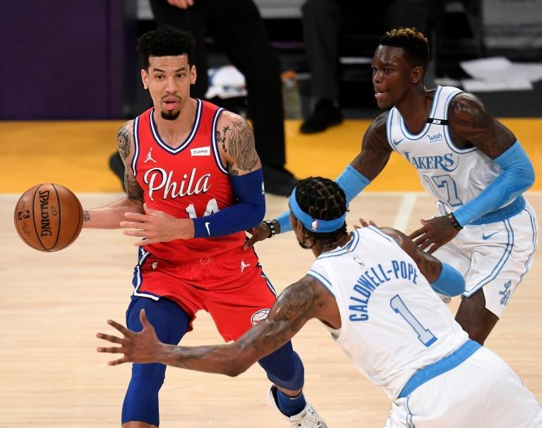 Philadelphia's Danny Green looks to pass as he is guarded by Dennis Schroder and Kentavious Caldwell-Pope