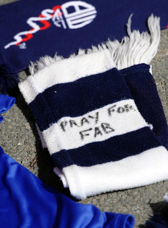 A football scarf with a message of support is left at the stadium's Book of Remembrance at The Reebok Stadium in Bolton, north-west England on March 18, 2012 the morning after Bolton Wanderers' English midfielder Fabrice Muamba collapsed during their FA cup football match against Tottenham Hotspur in London. Muamba remains in 'critical condition' according to the hospital. AFP PHOTO / PAUL ELLIS