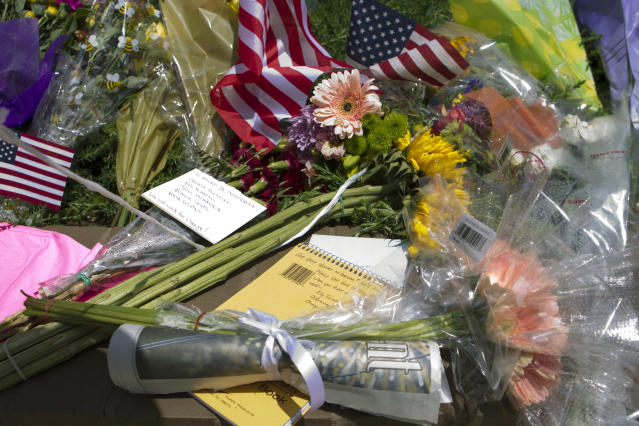 <p>Flowers book notes and a newspaper are left in a makeshift memorial at the scene were five journalist were shot at their newspaper office in Annapolis, Md., Friday, June 29, 2018. (Photo: Jose Luis Magana/AP) </p>