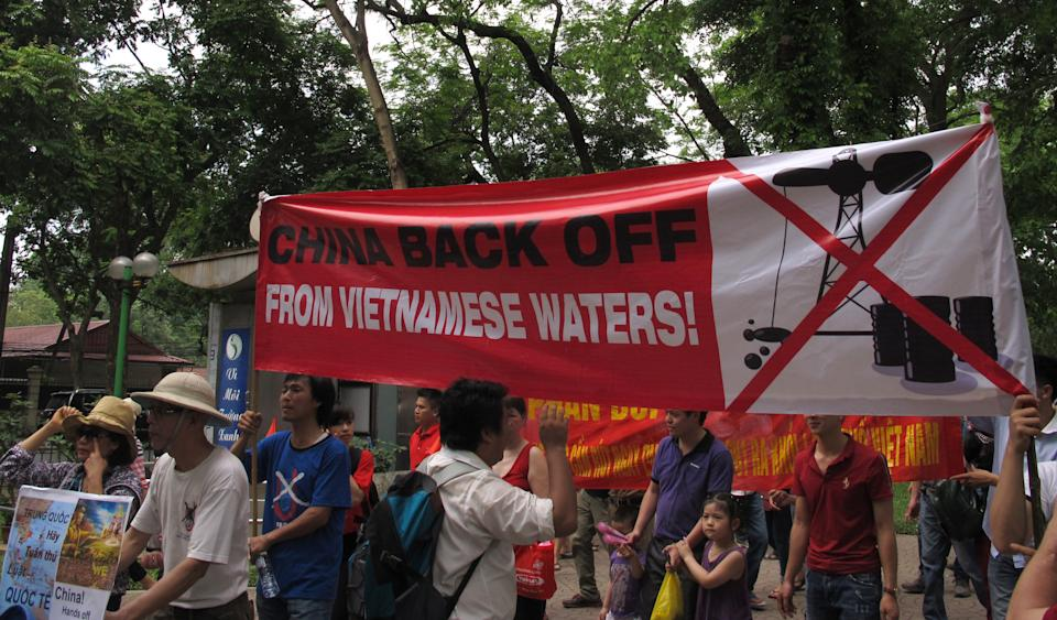 Vietnamese protest outside the Chinese Embassy on Sunday, May 11, 2014 in Hanoi, Vietnam, against Beijing's deployment of an oil rig in the contested waters of the South China Sea. The deployment of the rig has a triggered a tense standoff in the ocean and raised fears of confrontation between the neighboring  countries. (AP Photo/Chris Brummitt)
