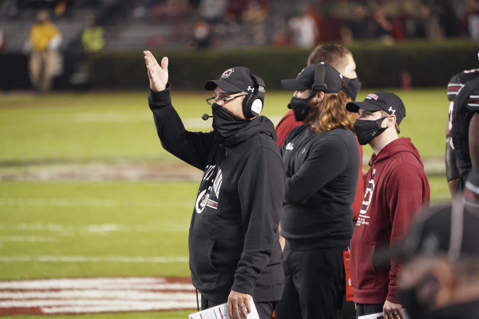South Carolina interim head coach Mike Bobo reacts to an official's call during the first half of an NCAA college football game against Missouri, Saturday, Nov. 21, 2020, in Columbia, S.C. (AP Photo/Sean Rayford)