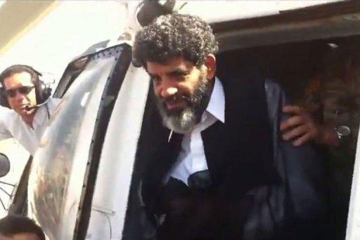 Abdullah al-Senussi, a former spy of late Libyan leader Moamer Kadhafi, arrives at the high security prison in Tripoli