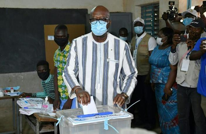 Ahead: President Roch Marc Christian Kabore, seen casting his vote in the capital Ouagadougou on Sunday