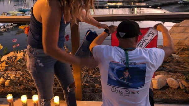 JJ Lambert, 38, and his fiancee, Jenna Marsala, 33, hang up a dive flag in remembrance of the victims of the Conception boat fire at a memorial site on Monday, Sept. 2, 2019, in Santa Barbara, Calif. A fire raged through the boat carrying recreationa (The Associated Press)