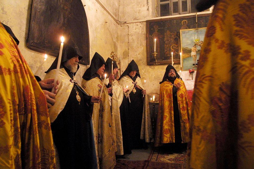 BETHLEHEM, WEST BANK:  Armenian Orthodox Patriarch of Jerusalem, Torkom Manugian (2L-with scepter), leads the noon service in the Church of the Nativity in the West Bank town of Bethlehem, the biblical birthplace of Jesus Christ. File photo: 2003