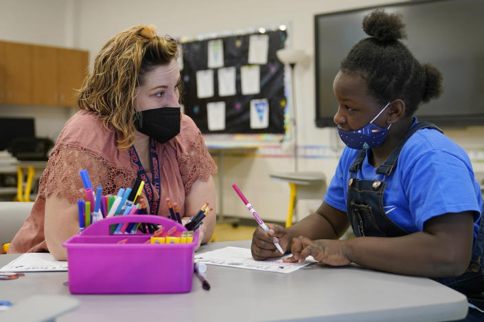 Teacher Amanda Martinez works one-on-one with a third grade student at Positive Tomorrows, Tuesday, Aug. 17, 2021, in Oklahoma City. Positive Tomorrows, an Oklahoma City school exclusively for students in families experiencing homelessness, received money from Gov. Kevin Stitt's Stay in School program and forgivable Paycheck Protection Program loans from the federal government. (AP Photo/Sue Ogrocki)