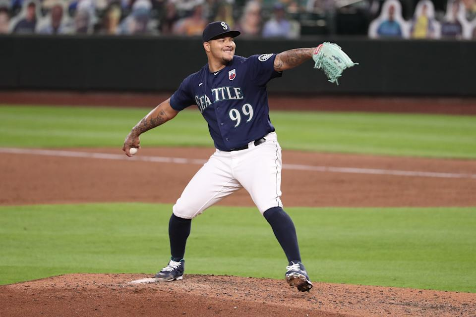SEATTLE, WASHINGTON - AUGUST 19: Taijuan Walker #99 of the Seattle Mariners pitches in the fifth inning against the Los Angeles Dodgers at T-Mobile Park on August 19, 2020 in Seattle, Washington. (Photo by Abbie Parr/Getty Images)