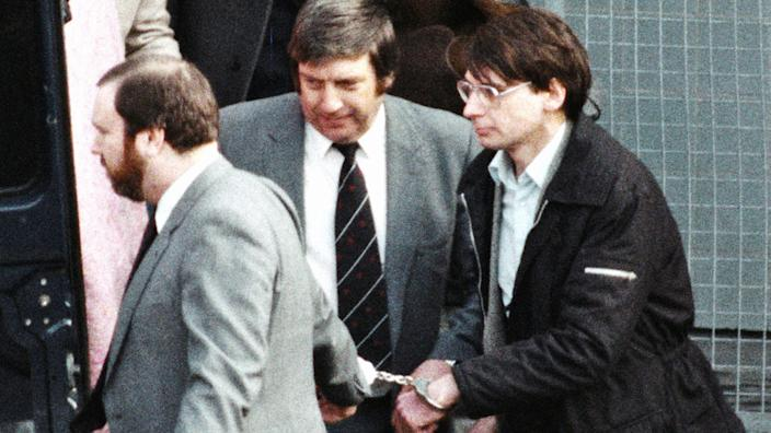 The real Dennis Nilsen (right) being led in handcuffs by police in 1983