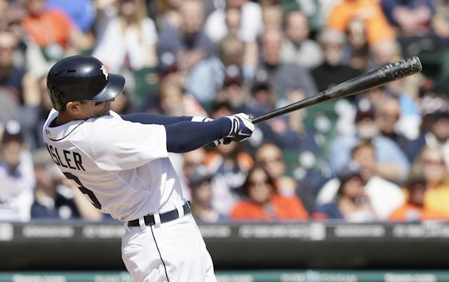 Detroit Tigers' Ian Kinsler connects for a two-run home run during the fifth inning of a baseball game against the Cleveland Indians in Detroit, Thursday, April 17, 2014. (AP Photo/Carlos Osorio)