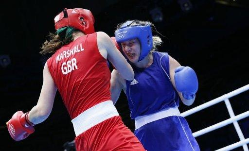 Savannah Marshall of Great Britain (in red) defends against Marina Volnova of Kazakhstan