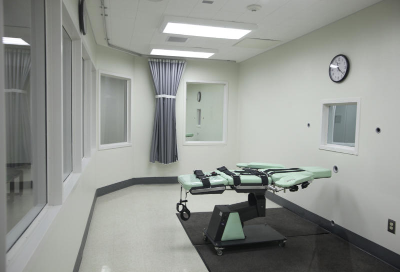 FILE - In this Sept. 21, 2010 file photo is the death chamber of the new lethal injection facility at San Quentin State Prison in San Quentin, Calif. Seven years after Scott Peterson was sentenced to death for murdering his pregnant wife Laci, his appeal is moving at lightning speed, at least compared to those of his 725 fellow California Death Row inmates. Appealing the death penalty in California can take two decades, meaning that condemned prisoners are more likely to die behind bars of natural causes than be executed. Now voters in California get an opportunity this November to vote on a measure that would abolish the death penalty. (AP Photo/Eric Risberg, File)
