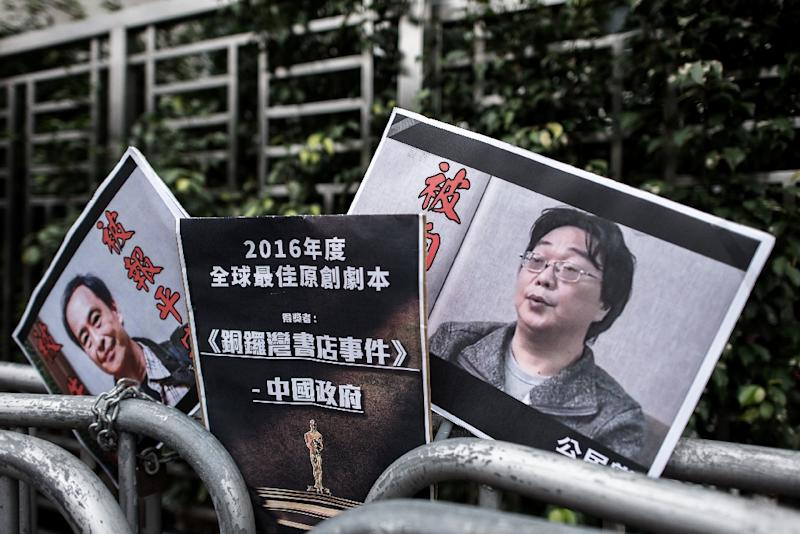 Placards showing missing bookseller Lee Bo (L) and his associate Gui Minhai (R) are seen in Hong Kong in January 2016 (AFP Photo/PHILIPPE LOPEZ)