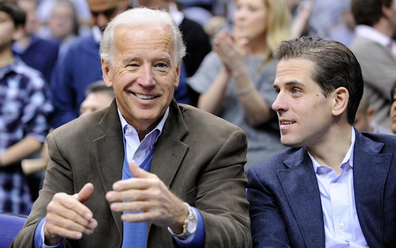 Joe Biden with his son Hunter at a basketball game in Washington in 2010 - Nick Wass/AP Photo