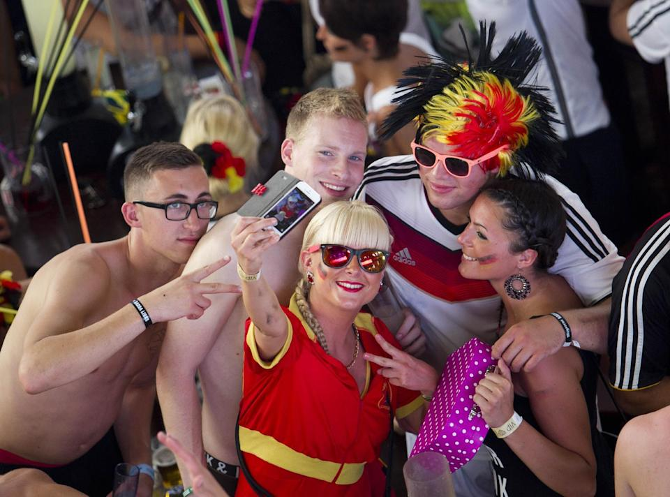 Supporters of Germany's national football team take a selfie as they watch the FIFA World Cup 2014 group G football match Germany vs USA on a giant screen at a club in Palma de Mallorca on June 26, 2014 (AFP Photo/Jaime Reina)