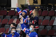 Fans of the New York Rangers celebrate in the third period of an NHL hockey game against the New Jersey Devils, Thursday, March 4, 2021, in Newark, N.J. The Rangers defeated the Devils 6-1. (AP Photo/Kathy Willens)