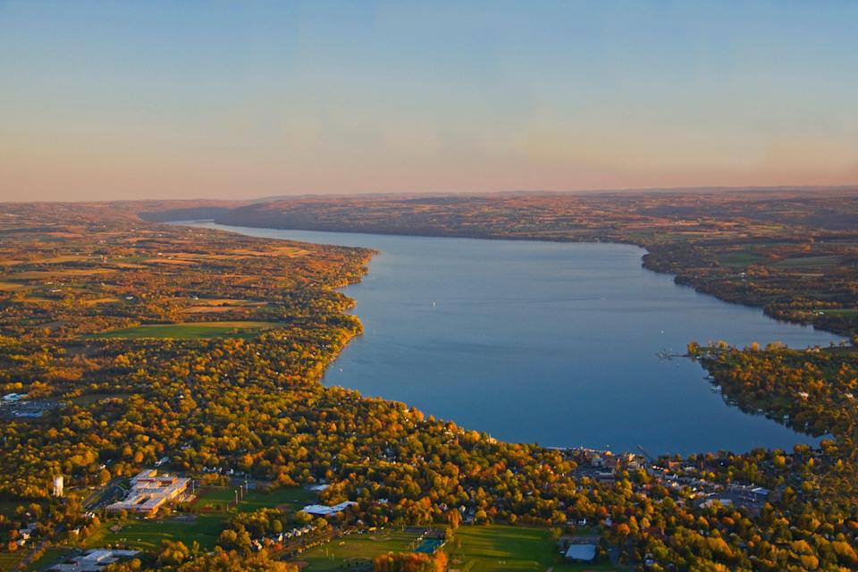 """Covering over 9,000 square miles that wrap around 11 narrow blue lakes, New York's <a href=""""https://www.cntraveler.com/story/the-fresh-allure-of-new-yorks-finger-lakes?mbid=synd_yahoo_rss"""" rel=""""nofollow noopener"""" target=""""_blank"""" data-ylk=""""slk:Finger Lakes"""" class=""""link rapid-noclick-resp"""">Finger Lakes</a> region is a natural marvel. It's the ultimate escape for families seeking a vacation filled with outdoor adventure, farm-to-table food (we love the restaurant at <a href=""""http://www.elderberrypond.com/index.html"""" rel=""""nofollow noopener"""" target=""""_blank"""" data-ylk=""""slk:Elderberry Pond"""" class=""""link rapid-noclick-resp"""">Elderberry Pond</a>, which sits on its own farm, for a special, """"we're-on-vacation"""" lunch), and, when the season is right, ample leaf peeping opportunities. Spend a few nights at the recently opened <a href=""""https://prf.hn/l/75yVWWR"""" rel=""""nofollow noopener"""" target=""""_blank"""" data-ylk=""""slk:Lake House on Canandaigua"""" class=""""link rapid-noclick-resp"""">Lake House on Canandaigua</a>, just a five-minute walk from Canandaigua Lake State Marine Park. Not only is the hotel easy on the eyes, with its warm, breezy design; it also provides plenty of prime family time extracurriculars, including kite flying, bike riding, and arts and crafts activities like print-making and rock painting. Beyond hotel walls, the <a href=""""https://www.museumofplay.org/"""" rel=""""nofollow noopener"""" target=""""_blank"""" data-ylk=""""slk:Strong National Museum of Play"""" class=""""link rapid-noclick-resp"""">Strong National Museum of Play</a> has plenty of interactive games for kids, like DanceLab and Imagination Destination, while the <a href=""""https://home.cmog.org/"""" rel=""""nofollow noopener"""" target=""""_blank"""" data-ylk=""""slk:Corning Museum of Glass"""" class=""""link rapid-noclick-resp"""">Corning Museum of Glass</a> offers them a chance to create their very own glass-blown souvenir."""