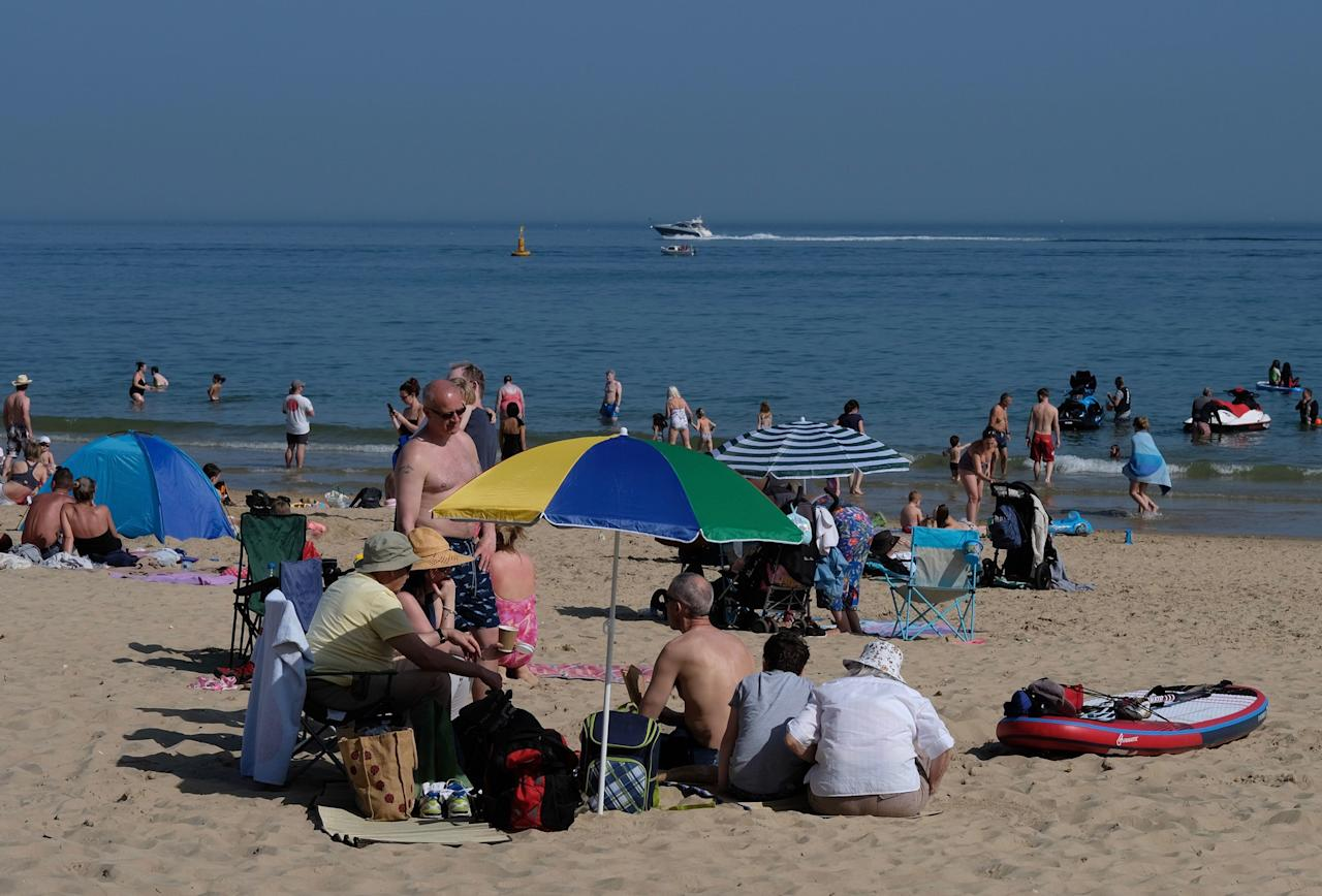 <p>Sun worshippers hit Branksome Beach, Poole, as Britain sizzled in a spring heatwave (Picture: PA) </p>