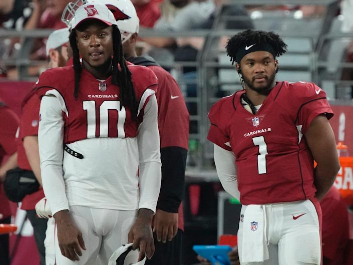DeAndre Hopkins and Kyler Murray stand next to each other on the sideline of Cardinals preseason game.