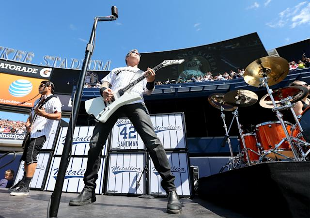 NEW YORK, NY - SEPTEMBER 22: James Hetfield and Kirk Hammett (L) of Metallica perform Enter Sandman to honor pitcher Mariano Rivera #42 of the New York Yankees during the Mariano Rivera Day pregame ceremony during an interleague game against the San Francisco Giants on September 22, 2013 at Yankee Stadium in the Bronx borough of New York City. (Photo by Elsa/Getty Images)