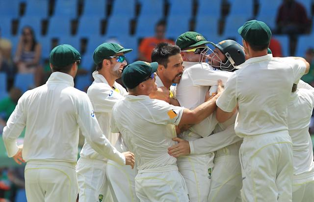 Australia's bowler Mitchell Johnson, center, celebrates with teammates after dismissing South Africa's captain Graeme Smith for 4 runs on the fourth day of their their cricket test match at Centurion Park in Pretoria, South Africa, Saturday, Feb. 15, 2014. (AP Photo/ Themba Hadebe)