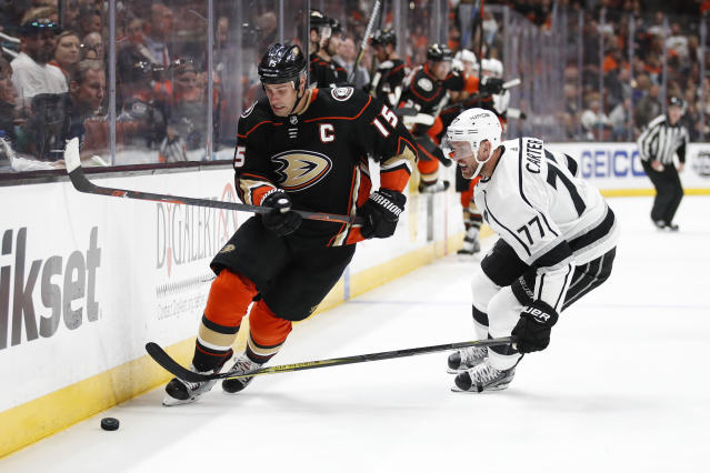 "Anaheim Ducks' <a class=""link rapid-noclick-resp"" href=""/nhl/players/3357/"" data-ylk=""slk:Ryan Getzlaf"">Ryan Getzlaf</a>, left, moves the puck under pressure by <a class=""link rapid-noclick-resp"" href=""/nhl/teams/los"" data-ylk=""slk:Los Angeles Kings"">Los Angeles Kings</a>' <a class=""link rapid-noclick-resp"" href=""/ncaaf/players/260291/"" data-ylk=""slk:Jeff Carter"">Jeff Carter</a> during the second period of an NHL hockey game Friday, March 30, 2018, in Anaheim, Calif. (AP Photo/Jae C. Hong)"
