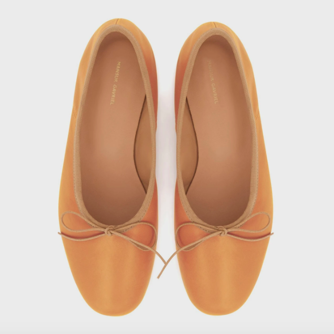 """<p><strong>Mansur Gavriel</strong></p><p>mansurgavriel.com</p><p><strong>$190.00</strong></p><p><a href=""""https://go.redirectingat.com?id=74968X1596630&url=https%3A%2F%2Fwww.mansurgavriel.com%2Fproducts%2Fvegetable-tanned-ballerina-cammello&sref=https%3A%2F%2Fwww.cosmopolitan.com%2Fstyle-beauty%2Ffashion%2Fg35017315%2F2021-shoe-trends%2F"""" rel=""""nofollow noopener"""" target=""""_blank"""" data-ylk=""""slk:Shop Now"""" class=""""link rapid-noclick-resp"""">Shop Now</a></p><p>Mansur's ballet flats have bow details on them, and you can also get them monogrammed for a personal rouch. </p>"""