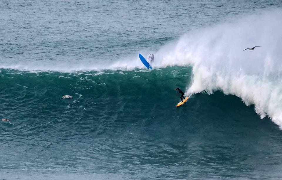 Surfers tackle the famous Cribbar wave in Cornwall. (SWNS)