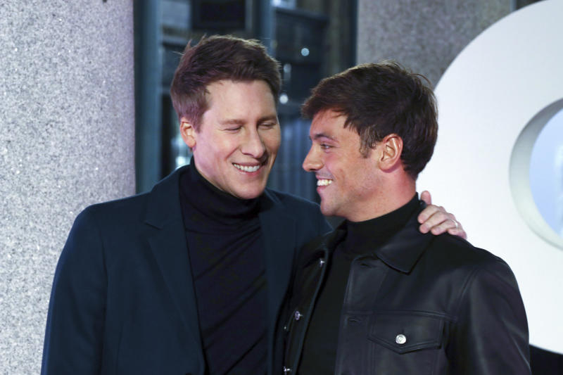 Olympic Diver Tom Daley, right, and partner Dustin Lance Black pose for photographers on arrival at the GQ Magazine 30th Anniversary celebrations, in London, Monday, Oct. 29, 2018. (Photo by Grant Pollard/Invision/AP)