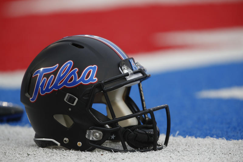 An Tulsa football helmet sits on the sideline before an NCAA football game against SMU, Saturday, Oct. 31, 2015, in Dallas. (AP Photo/Jim Cowsert)