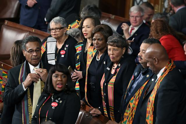 <p>Members of Congress wear black clothing and kente cloth in protest at the State of the Union address in the chamber of the U.S. House of Representatives on Jan. 30 in Washington, D.C. (Photo: Mark Wilson/Getty Images) </p>