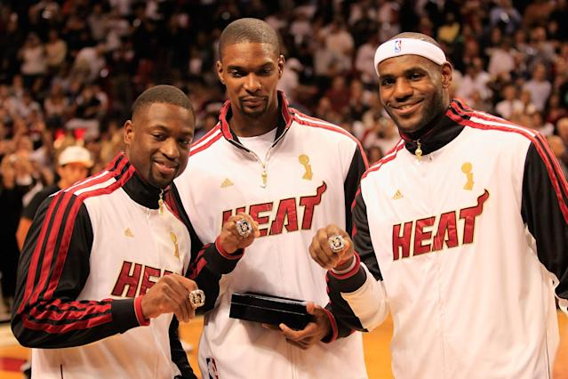 MIAMI, FL - OCTOBER 30: (L) Dwyane Wade #3 of the Miami Heat, (C) Chris Bosh #1 of the Miami Heat and (R) LeBron James #6 of the Miami Heat pose with their 2012 NBA Championship rings prior to the game against the Boston Celtics at American Airlines Arena on October 30, 2012 in Miami, Florida. NOTE TO USER: User expressly acknowledges and agrees that, by downloading and/or using this Photograph, user is consenting to the terms and conditions of the Getty Images License Agreement. (Photo by Chris Trotman/Getty Images)