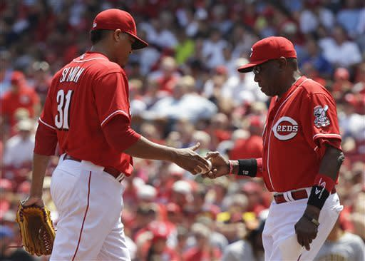 Cincinnati Reds manager Dusty Baker takes relief pitcher Alfredo Simon (31) out in the seventh inning of a baseball game against the Pittsburgh Pirates, Thursday, June 20, 2013, in Cincinnati. Simon gave up three runs in the inning and was the losing pitcher in the game won by Pittsburgh 5-3. (AP Photo/Al Behrman)