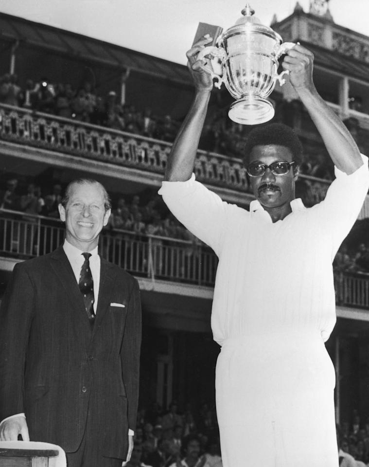 M.C.C. president Prince Philip, Duke of Edinburgh looks on as West Indies captain Clive Lloyd raises the trophy after his team won the final of the Prudential World Cup against Australia, 23rd June 1975. (Photo by Keystone/Hulton Archive/Getty Images)
