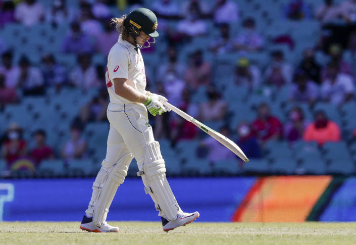 Australia's Will Pucovski walks from the field after he was dismissed during play on day three of the third cricket test between India and Australia at the Sydney Cricket Ground, Sydney, Australia, Saturday, Jan. 9, 2021. (AP Photo/Rick Rycroft)