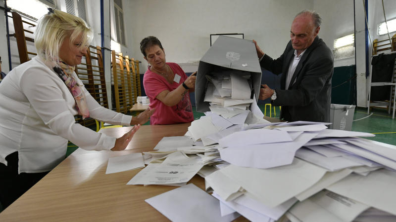 Members of a local election committee empty a ballot box for counting at a polling station at the end of local elections in Budapest, Hungary, Sunday Oct. 13, 2019. Prime Minister Viktor Orban's dominant right-wing Fidesz party was facing a challenge Sunday from opposition parties who are backing joint candidates in many cities in Hungary's nationwide local election. (Zsolt Szigetvary/MTI via AP)