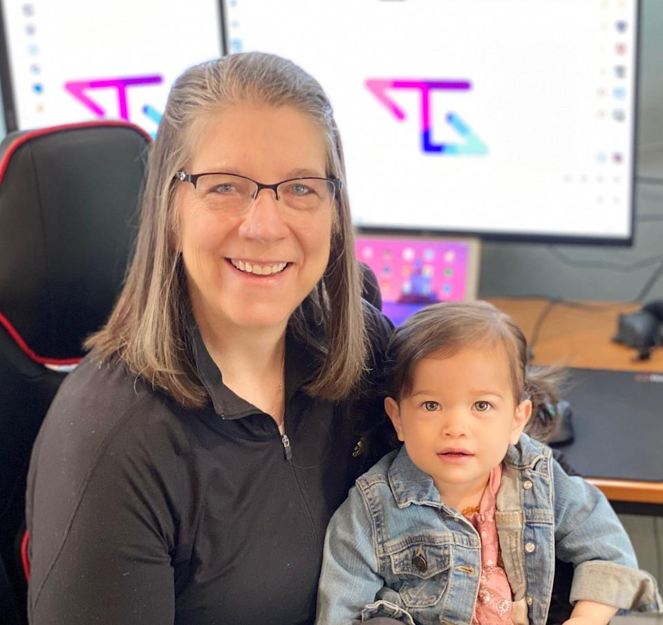 Michelle Statham, known to her TikTok followers as 'Tactical Gramma,' poses for a photo with one of her grandkids.